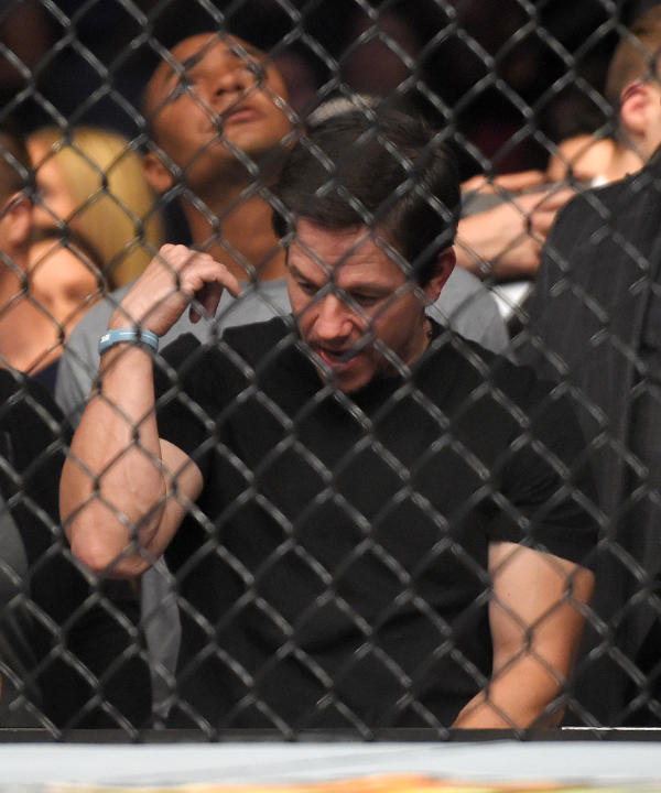 Actor Mark Wahlberg reacts as he watches a replay of the fight between Ronda Rousey  and Cat Zingano in a UFC 184 mixed martial arts bantamweight title bout, Saturday, Feb. 28, 2015, in Los Angeles. R