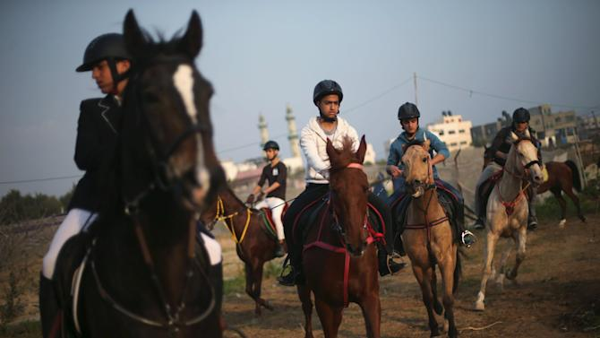 Palestinian youths ride horses during a local competition organised by Palestinian Equestrian Federation in Gaza City
