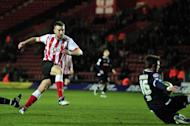 Southampton striker Rickie Lambert scores a goal during their FA Cup fourth round replay football match. The south-coast club have clinched promotion to the Premier League with a 4-0 victory over Coventry on the final day of the Championship campaign