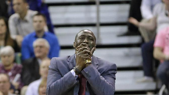 Utah Jazz's head coach Tyrone Corbin reacts to a call in the fourth quarter during an NBA basketball game against the Dallas Mavericks Wednesday, March 12, 2014, in Salt Lake City. The Mavericks won 108-101