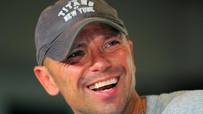 "Country singer Kenny Chesney appears at a news conference to promote his ""Brothers of the Sun"" concert tour on Friday June 1, 2012 in Tampa, Fla. Chesney and fellow country singer Tim McGraw will kick off their joint tour on Saturday night in Tampa, Fla. (Photo by Scott Miller/Invision/AP)"