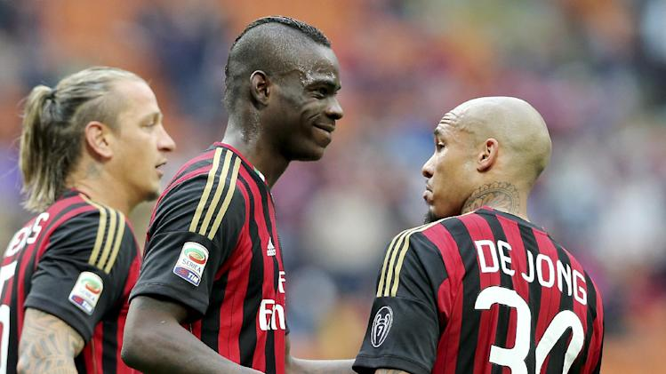 AC Milan forward Mario Balotelli, second from left, celebrates with his teammates Philippe Mexes, left, of France, and Nigel de Jong, of the Netherlands, after scoring during the Serie A soccer match between AC Milan and Livorno at the San Siro stadium in Milan, Italy, Saturday, April 19, 2014