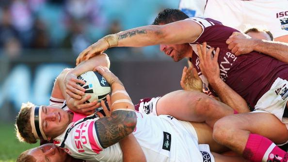 Jake Friend of the Roosters is held up over the tryline during the round 16 NRL match between the Sydney Roosters and the Manly Sea Eagles at Allianz Stadium on June 24, 2012 in Sydney, Australia. (Photo by Cameron Spencer/Getty Images)