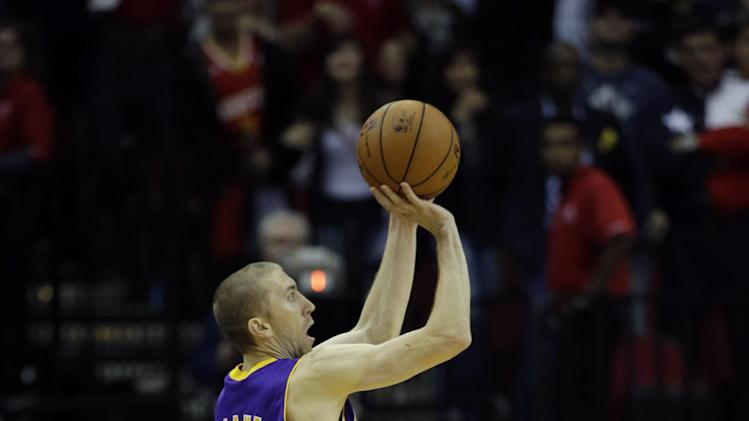 Los Angeles Lakers' Steve Blake (5) shoots his game-winning three-point basket against the Houston Rockets during the closing seconds of the fourth quarter of an NBA basketball game Thursday, Nov. 7, 2013, in Houston. The lakers won 99-98