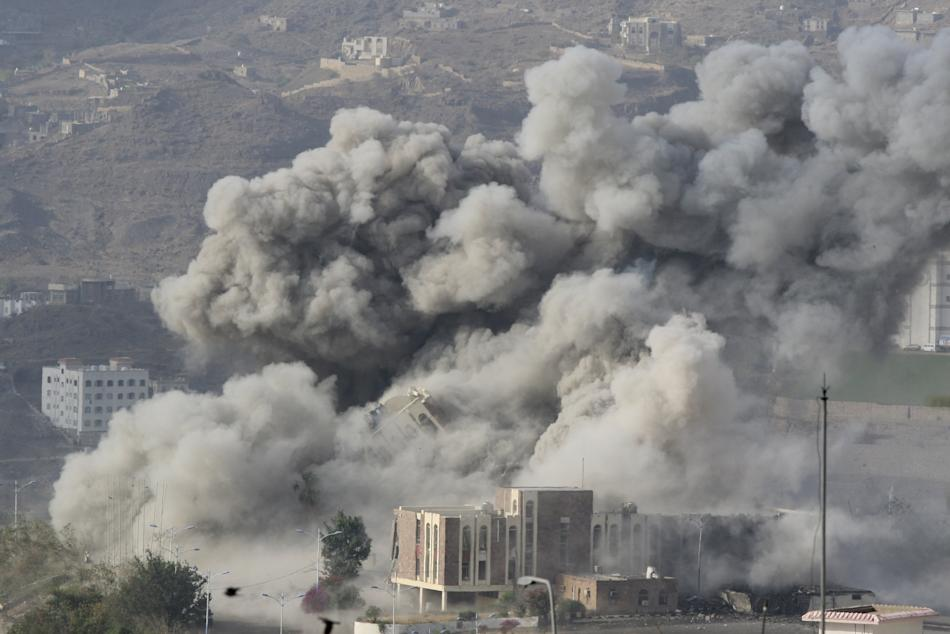 Smoke billows during an air strike on the Republican Palace in Yemen's southwestern city of Taiz