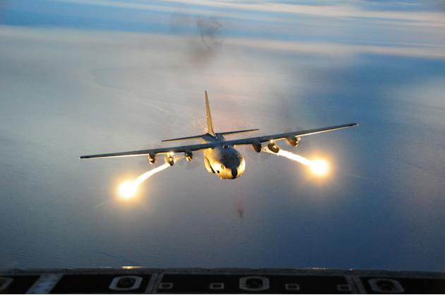 A C-5 Galaxy with the 107th Airlift Wing, shoots live flares during a night formation training mission (Ray Lloyd/USAF/Rex Features)