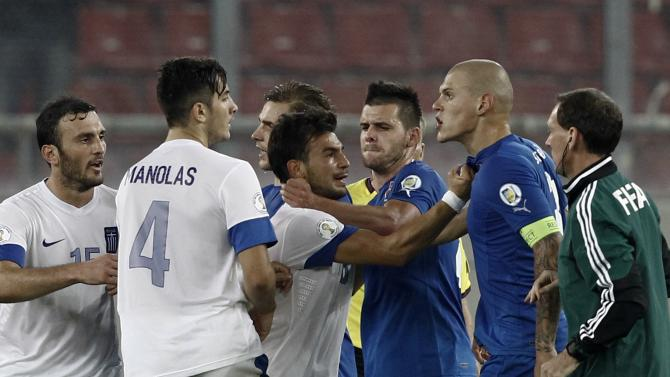 Slovakia's Skrtel argues with Greece's Ninis during their 2014 World Cup qualifying soccer match at Karaiskaki stadium in Piraeus near Athens