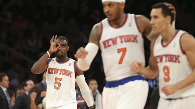 New York Knicks shooting guard Tim Hardaway Jr. (5) gestures as forward Carmelo Anthony (7) celebrates after a basket made by point guard Pablo Prigioni (9) during the second half of an NBA basketball game against the Atlanta Hawks, Saturday, Dec. 14, 2013, in New York. The Knicks won 111-106