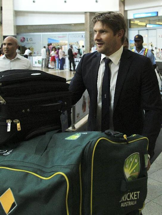Australia's cricket player Shane Watson pushes a trolley with his bags during his arrival at OR Tambo International Airport in Johannesburg, South Africa, Wednesday, Jan. 29, 2013, for Australia&#