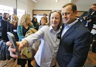 FILE - In this Jan. 5, 2017 file photo, a supporter takes a selfie photo with former Virginia congressman, Tom Perriello, after speaking during a rally in Charlottesville, Va., announcing his candidacy for the Democratic nomination for governor of Virginia. In what sounds like an echo of 2016, governor's races this year in Virginia and New Jersey are being swept up in many of the same political currents that emerged during last year's turbulent presidential campaign. (AP Photo/Steve Helber)