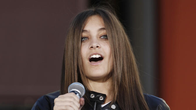 FILE - This Jan. 26, 2012 file photo shows Paris Jackson, daughter of the late pop icon Michael Jackson, speaking during a hand and footprint ceremony honoring her father at Grauman's Chinese Theatre in Los Angeles. Paris Jackson is physically fine after being taken to a hospital early Wednesday, June 5, 2013, an attorney for Jackson's mother said. Perry Sanders Jr. writes in a statement that Paris Jackson is getting appropriate medical attention and the family is seeking privacy. Fire and sheriff's officials confirmed they transported someone from a home in Paris' suburban Calabasas neighborhood for a possible overdose but did not release any identifying information or additional details. (AP Photo/Matt Sayles, file)