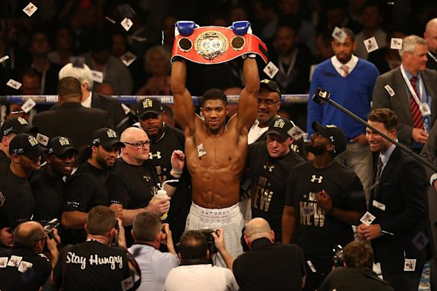 British boxer Anthony Joshua celebrates beating US boxer Charles Martin (not pictured) following their IBF World Heavyweight title boxing match at the O2 arena in London on April 9, 2016