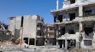 A handout picture released by the Syrian opposition's Shaam News Network shows damages in the district of Juret al-Shayah in the flashpoint city of Homs on July 3. AFP cannot independently verify this image