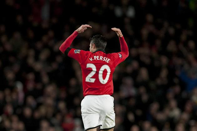 Manchester United's Robin van Persie celebrates after scoring against Fulham during their English Premier League soccer match at Old Trafford Stadium, Manchester, England, Sunday Feb. 9, 2014. (AP Pho