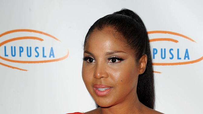 "FILE - This Nov. 1, 2012 file photo shows singer and TV personality Toni Braxton at the  Lupus LA's Hollywood Bag Ladies Luncheon in Beverly Hills, Calif. Braxton's autistic son makes his acting debut in her upcoming Lifetime movie ""Twist of Faith.""  (Photo by Katy Winn/Invision/AP, file)"