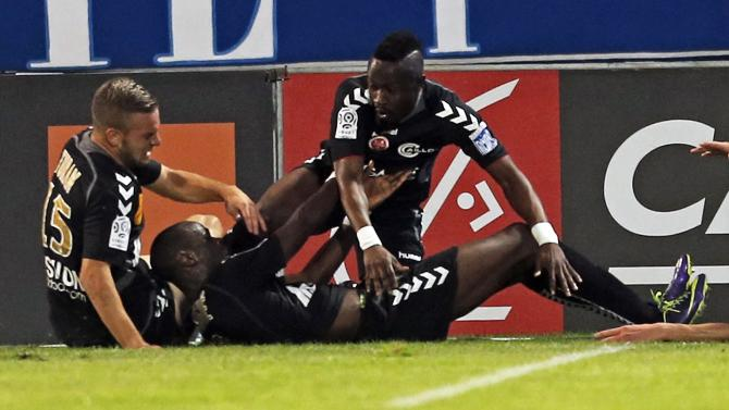 O'Niangue of Reims reacts with team mates after scoring against Olympique Marseille during their French Ligue 1 soccer match at the Velodrome stadium in Marseille