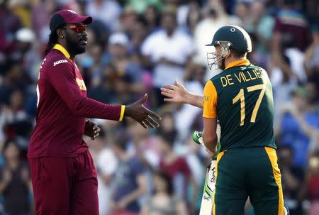 South Africa's AB de Villiers shakes hands with West Indies player Chris Gayle after finishing the innings during their Cricket World Cup match at the SCG