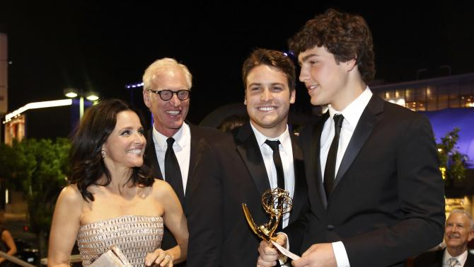 Actress Julia Louis-Dreyfus and her family arrive at the Governors Ball for the 65th Primetime Emmy Awards in Los Angeles