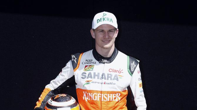Force India Formula One driver Nico Hulkenberg of Germany poses during a photo session before the Australia Formula One Grand Prix, at Melbourne's Albert Park Track