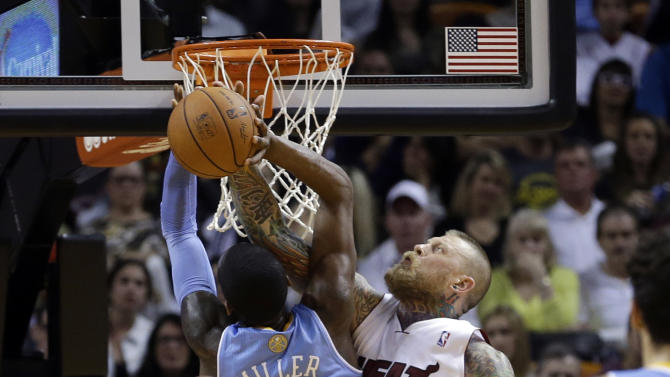 Miami Heat forward Chris Andersen (11) blocks a shot by Denver Nuggets forward Quincy Miller (30) during the first half of an NBA basketball game in Miami, Friday, March 14, 2014. (AP Photo/Alan Diaz)