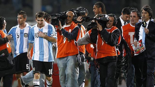 Messi leads Argentina to top of table