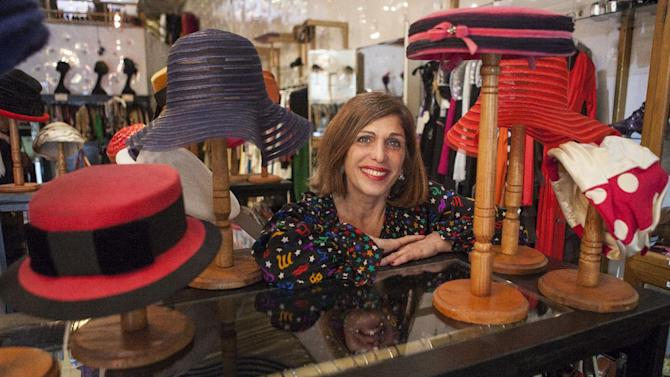 """In this photo taken Thursday, Feb. 21, 2013, owner Doris Raymond poses for a photo at her Hollywood high-end vintage store, """"The Way We Wore,"""" in the La Brea District of Los Angeles. Raymond's vintage clothing and accessories store is featured in the reality TV series, """"L.A. Frock Stars,"""" which debuts March 7, 2013 on the Smithsonian Channel. (AP Photo/Damian Dovarganes)"""