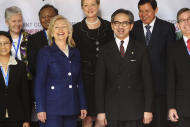 U.S. Secretary of State Hillary Rodham Clinton, front row second left, and Indonesian Foreign Minister Marty Natalegawa, front row second right, pose for a group photo with U.S. and Indonesian senior officials during the opening of the Joint Commission Meeting between Indonesia and U.S. in Nusa Dua, Bali, Indonesia, Sunday, July 24, 2011. (AP Photo/Dita Alangkara, Pool)