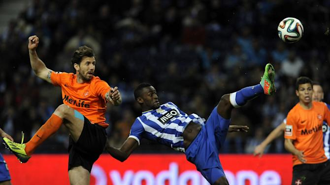 FC Porto's Jackson Martinez, from Colombia, goes for the ball with Belenenses' Goncalo Brandao, left, in a Portuguese League soccer match at the Dragao stadium in Porto, Portugal, Sunday, March 23, 2014. Porto won 1-0