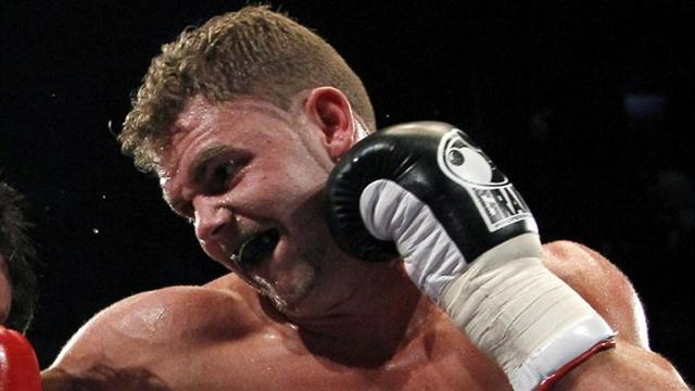 Boxing - Saunders retains titles in Bethnal Green