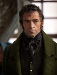 "FILE - This publicity image released by Universal Pictures shows Hugh Jackman as Jean Valjean in a scene from ""Les Miserables."" The film is nominated for an Academy Award in the Makeup and Hairstyling category. The 85th Academy Awards air live on ABC on Sunday, Feb. 24, 2013. (AP Photo/Universal Pictures, Laurie Sparham, File)"