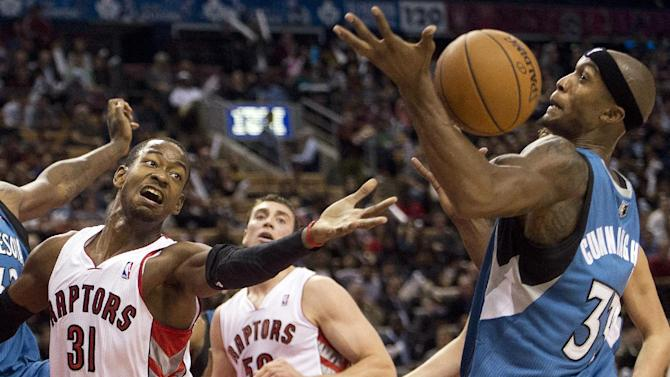 Toronto Raptors forward Terrence Ross (31) battles for the loose ball against Minnesota Timberwolves forward Dante Cunningham, right, during the first half of an NBA preseason basketball game in Toronto on Wednesday, Oct. 9, 2013
