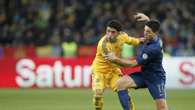 Ukraine's Edmar fights for the ball with France's Samir Nasri during their 2014 World Cup qualifying first leg playoff soccer match at the Olympic stadium in Kiev