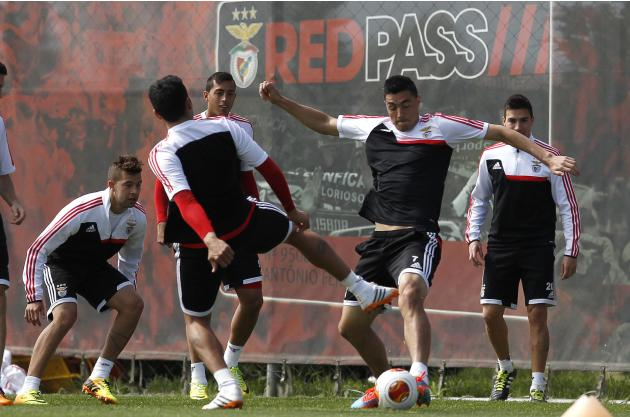 Benfica's Oscar Cardozo fights for the ball during a training session in Seixal
