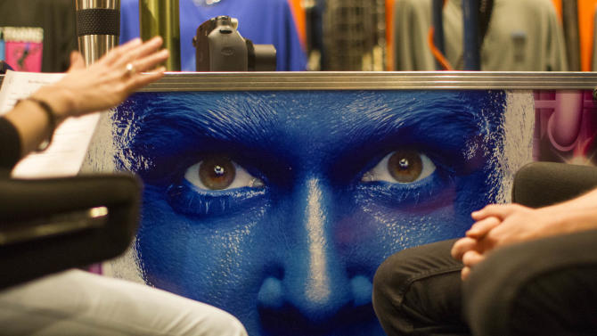 In this July 9, 2013 photograph, Rachel Schripsema, left, interviews Blue Man Group hopeful Ian McCabe during a casting call at the Briar Street Theatre in Chicago. Blue Man Group, which started with three friends in New York more than two decades ago, has grown from an off-Broadway show to also have productions in Boston, Chicago, Las Vegas and Orlando, Fla. A tour will soon take the blue men to stops in cities like Atlantic City, N.J.; Durham, N.C.; Lincoln, Neb.; Corpus Christi, Texas; Portland, Maine; and Kennewick, Wash. (AP Photo/Scott Eisen)