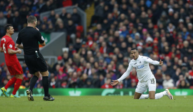 Swansea City's Martin Olsson appeals to referee Kevin Friend