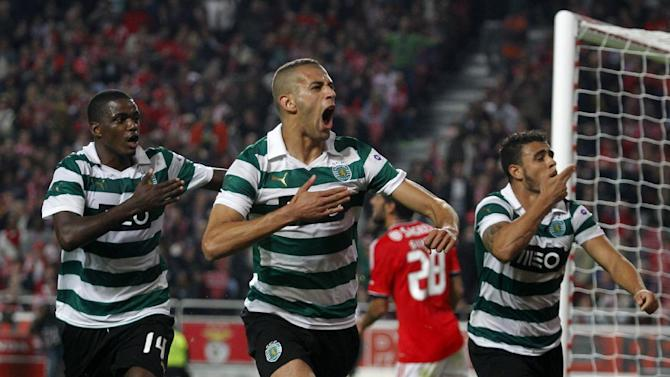 Sporting's Islam Slimani, center, from Algeria celebrates with teammates William Carvalho, left, from Angola and Mauricio Nascimento from Brazil after scoring their team's third and equalizer goal against Benfica during a Portugal Cup soccer match between Benfica and Sporting at Benfica's Luz stadium in Lisbon, Saturday, Nov. 9, 2013