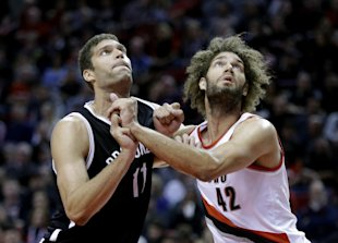 Robin Lopez is set to join his twin brother Brook in the Big Apple. (AP/Don Ryan)