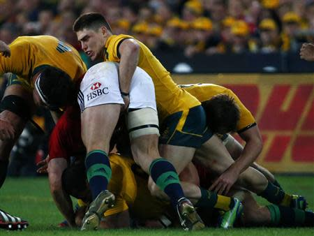 Australia Wallabies' James O'Connor moves in on British and Irish Lions' Jonathan Davies during their third and final rugby union test match at ANZ stadium in Sydney