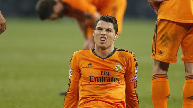 Real's Cristiano Ronaldo sits on the pitch during the Champions League round of the last 16 first leg soccer match between Schalke 04 and Real Madrid in Gelsenkirchen, Germany, Wednesday, Feb.26,2014. (AP Photo/Frank Augstein)