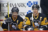 Pittsburgh Penguins' Sidney Crosby (87) sits on the bench during the first period of the team's NHL hockey game against the Winnipeg Jets in Pittsburgh, Thursday, Feb. 16, 2017. Crosby had assisted on a goal by Chris Kunitz for the 1,000th point of his NHL career, (AP Photo/Gene J. Puskar)