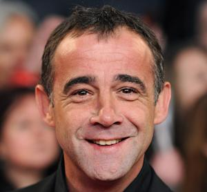 """FILE - In this Jan. 25, 2012 file photo, British actor  Michael Le Vell poses, in London.   Police have charged a longtime star of the British soap opera """"Coronation Street"""" with child sex offences including rape and indecent assault. Michael Le Vell, who has played mechanic Kevin Webster on the show for 30 years, faces 19 charges. Police say the charges relate to offences against a child between 2001 and 2010. He was originally arrested and questioned in 2011, but released without charge. Prosecutors said Friday, Feb. 15, 2013, they had overturned that decision. The 48-year-old actor, whose real name is Michael Turner, is due in court Feb. 27. (AP Photo/ Anthony Devlin/PA, File) UNITED KINGDOM OUT"""