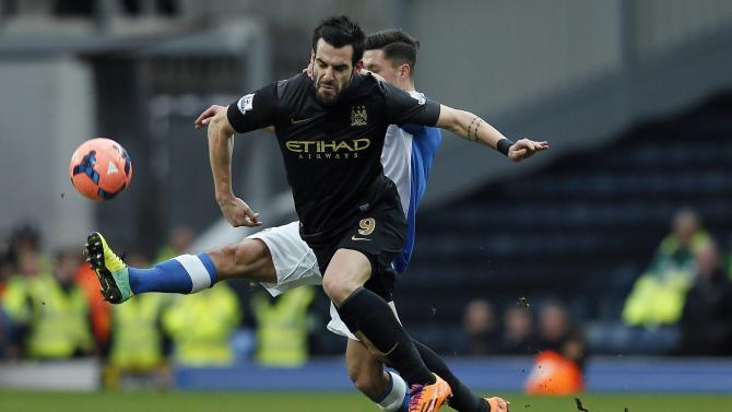 Blackburn Rovers' Lowe challenges Manchester City's Negredo during their FA Cup third round soccer match at Ewood Park in Blackburn, northwest England