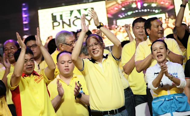 "Philippine President Benigno ""Noynoy"" Aquino with the Liberal Party (LP) senatorial candidates during the Team Pinoy Kick Off Campaign held in Plaza Miranda in Quiapo Manila, 12 February 2013. (Joseph Vidal/PRIB/NPPA Images)"
