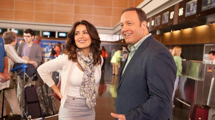 "This film image released by Columbia Picturers shows Salma Hayek, left, and Kevin James in a scene from ""Here Comes the Boom."" (AP Photo/Columbia-Sony Pictures, Tracy Bennett)"