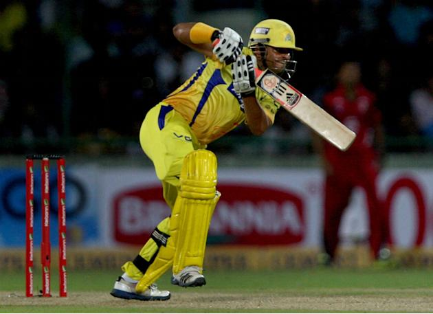 CSK batsman Suresh Raina plays a shot during the CLT20 match between Chennai Super Kings and Trinidad & Tobago at Feroz Shah Kotla, Delhi on Oct. 2, 2013. (Photo: IANS)