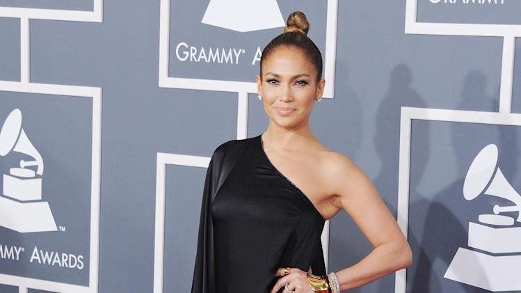 Who could forget Jennifer Lopez's plunging neckline at the 2000 Grammys? For sure this look is just as memorable as she pulls off an Angelina Jolie leg at this year's Grammys.