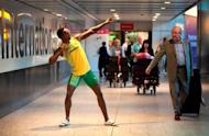 A waxworks model of Usain Bolt unveiled at Heathrow Airport's Terminal 5 last week. Bolt insists he is ready to defend his Olympic 100m and 200m titles after recovering from a mystery problem which has hampered his preparations for London