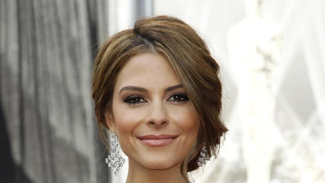FILE - In this Feb. 26, 2012 file photo, TV personality Maria Menounos arrives before the 84th Academy Awards in the Hollywood section of Los Angeles. Menounos will be among the 12 celebrity contestants on the next season of the ABC dancing competition, premiering March 19.  (AP Photo/Matt Sayles, file)