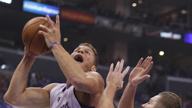 Los Angeles Clippers forward Blake Griffin (32) shoots over Golden State Warriors forward David Lee (10) in the first quarter during an NBA basketball game on Thursday, Oct. 31, 2013, in Los Angeles