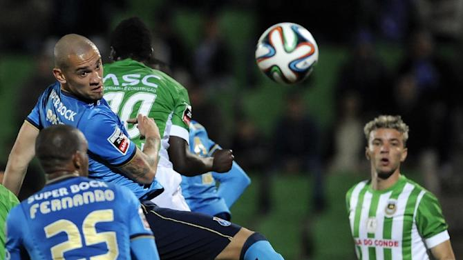 FC Porto's Maicon Roque, second left, from Brazil, jumps for the ball with  Rio Ave's Alhassan Wakaso, from Ghana, in a Portuguese League soccer match, in Vila do Conde, northern Portugal, Sunday, Dec. 15, 2013